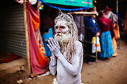 A Naga Sadhu with folded hands during the Hindu Festival of Maha Kumbh Mela Haridwar, Uttarakhand, India