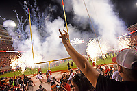 Fans cheer as the Wolfpack run out onto the field at Carter-Finley Stadium.
