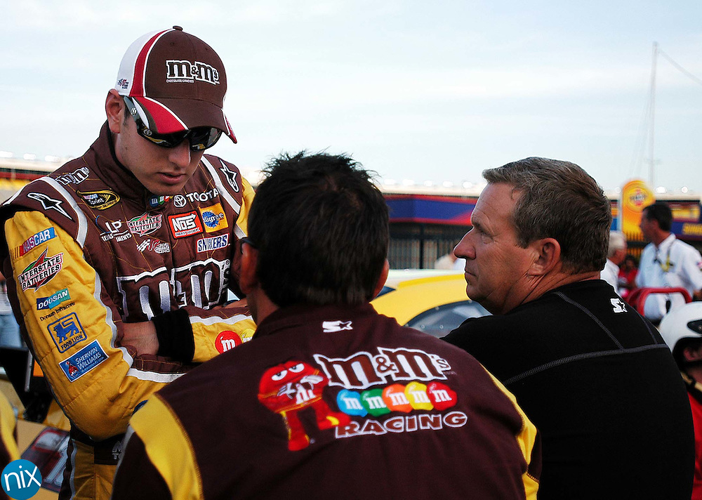 Kyle Busch talks with his crew members during qualifying for qualifying for the Coca-Cola 600 Thursday afternoon at Lowe's Motor Speedway. (phot0 by James Nix)
