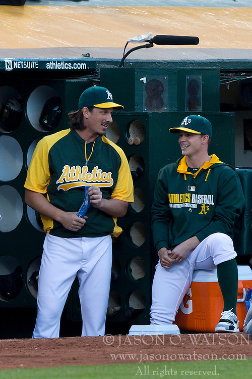 OAKLAND, CA - JULY 05:  Jeff Samardzija #29 of the Oakland Athletics talks to Sonny Gray #54 in the dugout during the fourth inning against the Toronto Blue Jays at O.co Coliseum on July 5, 2014 in Oakland, California. (Photo by Jason O. Watson/Getty Images) *** Local Caption *** Jeff Samardzija; Sonny Gray