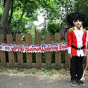 Tom Palmer, 8 years old dress up as a Queen's Guard by the entrance of Wimbledon Park Primary School to celebrate the Diamond Jubilee. London 1st June 2012