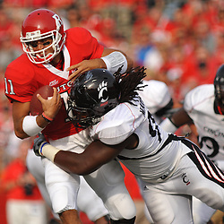 Sep 7, 2009; Piscataway, NJ, USA; Cincinnati defensive tackle Ricardo Mathews (90) sacks Rutgers quarterback Domenic Natale (11) during the first half of NCAA college football between Rutgers and Cincinnati at Rutgers Stadium.