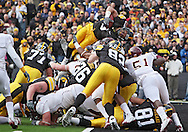 November 21, 2009: Iowa running back Brandon Wegher (3) dives over the top on a 1 yd touchdown run during the first half of the Iowa Hawkeyes 12-0 win over the Minnesota Golden Gophers at Kinnick Stadium in Iowa City, Iowa on November 21, 2009.