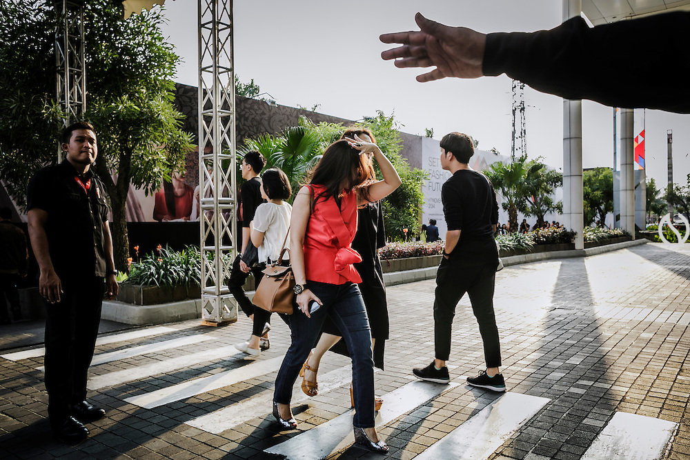 JAKARTA; TUESDAY, NOVEMBER 4, 2014; INDONESIA ECONOMIC RISING: People walk through an alley during a show of Jakarta Fashion Week in Jakarta, Indonesia, Tuesday, November 4, 2014. According to Asian Development Bank's 2014 report, Indonesia economy growth potential is in creative industry after for years relies heavily on natural resources such as mineral mining and palm oil. By the presidency of Joko Widodo, as a product of the third people election after the People Power Revolution in 1998, Indonesia is more confident in the economy growth and optimistic to become equal in quality to Brazil and China's economy growth. The emerging of Indonesia economy for the last one and a half decade after the end of Suharto's Dictatorship has been in significant way, the per capita growth has reached 400% under Susilo Bambang Yudhoyono presidency. Indonesia is home for 74 million of middle class as estimated by Boston Consulting Group, and  will double in 2020.