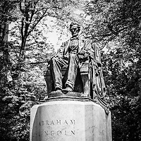 Black and white Chicago Abraham Lincoln sitting statue in Grant Park. The statue is named The Head of State and is also known as Seated Lincoln or Sitting Lincoln.
