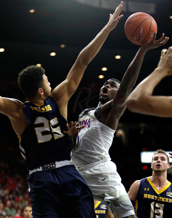 Arizona guard Kadeem Allen shoots around Northern Colorado forward Kai Edwards (25) during the second half of an NCAA college basketball game, Monday, Nov. 21, 2016, in Tucson, Ariz. Arizona defeated Northern Colorado 71-55. (AP Photo/Rick Scuteri)