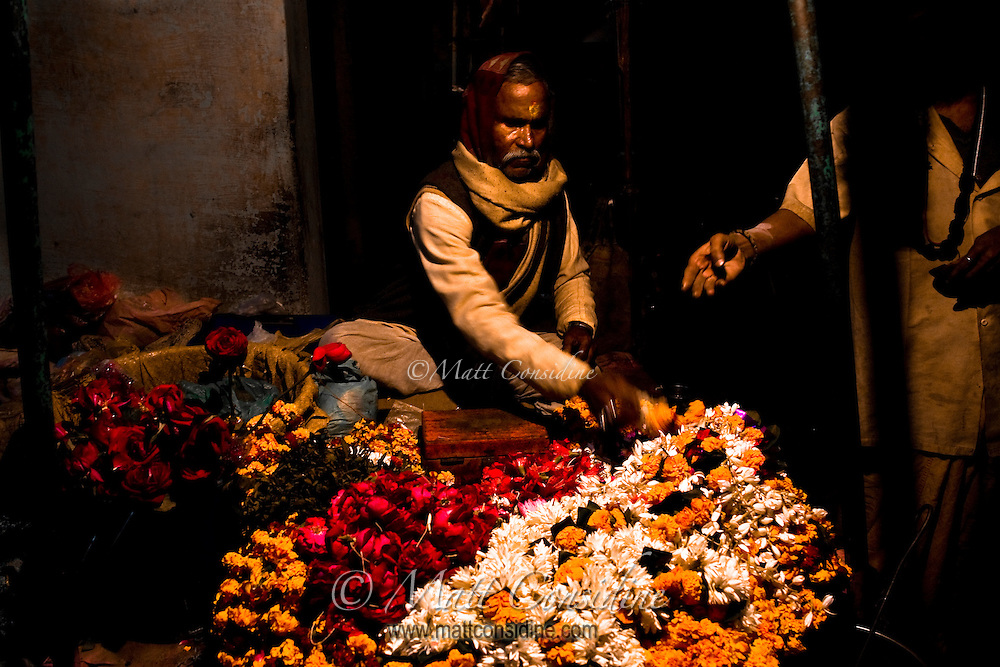 A splash of color amid the deep darkness of the backstreets of Varanasi.<br /> (Photo by Matt Considine - Images of Asia Collection)