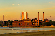 Sun sets on Glenwood Landing Power Plant, on Hempstead Harbor of Long Island's North Shore. Seen from North Hempstead Beach Park, Roslyn, New York U.S. 29th June 2013.