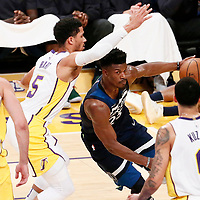 25 December 2017: Minnesota Timberwolves guard Jimmy Butler (23) drives past Los Angeles Lakers guard Josh Hart (5) during the Minnesota Timberwolves 121-104 victory over the LA Lakers, at the Staples Center, Los Angeles, California, USA.