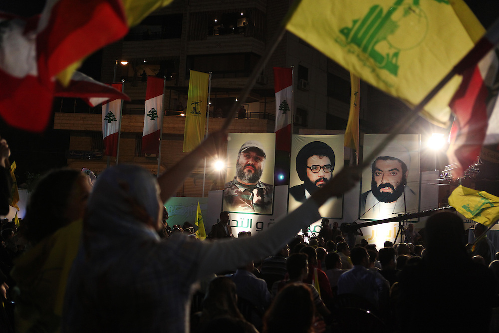 Supporters of the Shiite resistance and political group, Hizballah, rallied in the Dahiyeh southern suburbs of Beirut to watch a televised speech from Hizballah General Secretary Hassan Nasrallah. The rally was called for by Hizballah to celebrate Land Day, which is the 9th anniversary of Israel's withdrawal from southern Lebanon, which Hizballah and its supporters say was a victory over Israel. The rally comes just 13 days before Lebanese go to the polls to elect a new parliament. With Sunni Muslims and Shia Muslims mostly supporting their respective sectarian parties, Nasrallah praised Christian leader Michel Aoun. Aoun is head of the Free Patriotic Movement, which is allied with the Hizballah-led opposition March 8 coalition. ///Pictures of assassinated Hizballah members who were killed by Israel. On the left is Imad Moughniyeh, who was killed in 2008 and whose murder Hizballah still promises to avenge.