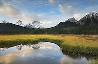 Peaks of the Spray Range reflected in still waters of the Smuts Creek wetlands, Peter Loughheed Provincial Park, Kananaskis Country, Alberta