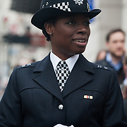 The funeral of former Prime Minister Margaret Thatcher who died Monday April 8. A black female police officer on duty.