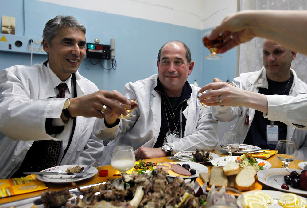 Americans Igor Bolshinsky (C) and Jay Thomas (Centre right) dine inside the nuclear reactor with Kazakh nuclear physicists, including Adil Tuleushev, director of  the Institute of Nuclear Physics, to celebrate the removal of highly enriched uranium from the institute in Almaty, Kazakhstan. .The removal of Kazakhstan's highly enriched uranium (HEU) is part of the U.S. Global Threat Reduction Initiative (GTRI), where Igor Bolshinsky and Kelly Cummins work, that tries to secure nuclear material around the world to prevent their misuse by terrorists and rogue states.