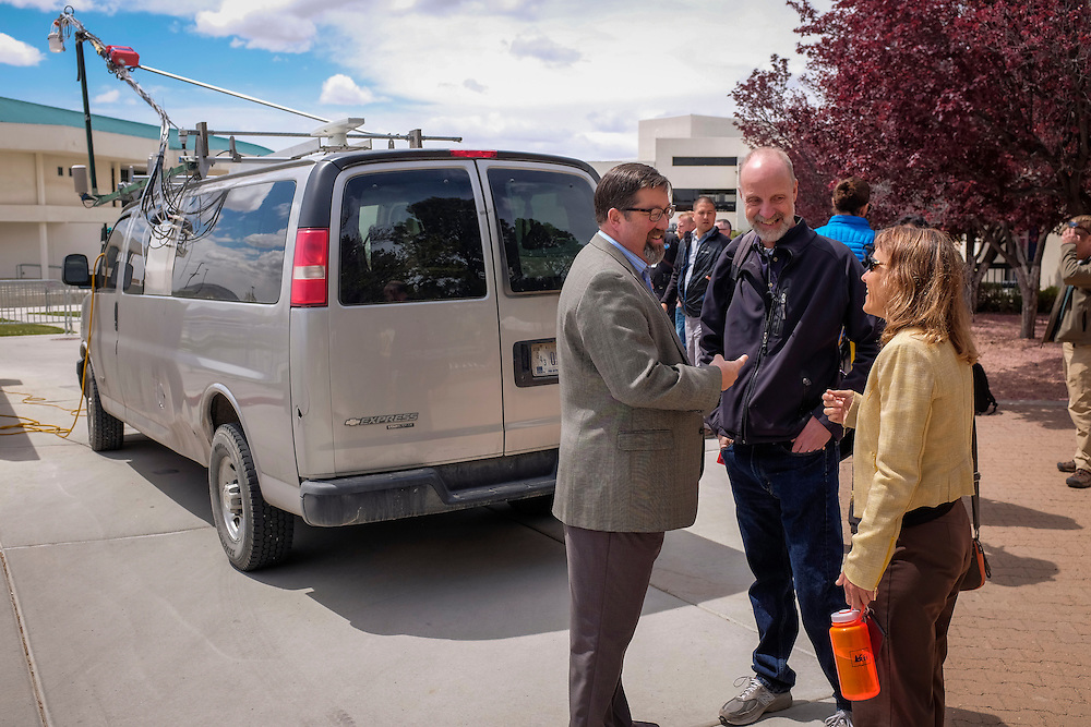 Southern Ute Indian Tribe Environmental Programs Division Head Tom Johnson, center, along with other professionals from the air quality and energy sectors take the opportunity to inspect the NOAA Mobile Laboratory, the vehicle used to collect data on methane levels throughout the region.