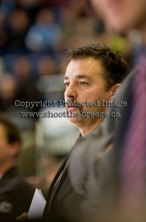 KELOWNA, CANADA, NOVEMBER 30: Dan Lambert, assistant coach of the Kelowna Rockets stands on the bench as the Tri City Americans visit the Kelowna Rockets  on November 30, 2011 at Prospera Place in Kelowna, British Columbia, Canada (Photo by Marissa Baecker/Shoot the Breeze) *** Local Caption *** Dan Lambert;