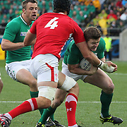 "Brian O""Driscoll, Ireland, is tackled by Luke Charteris, Wales, during the Ireland V Wales Quarter Final match at the IRB Rugby World Cup tournament. Wellington Regional Stadium, Wellington, New Zealand, 8th October 2011. Photo Tim Clayton..."