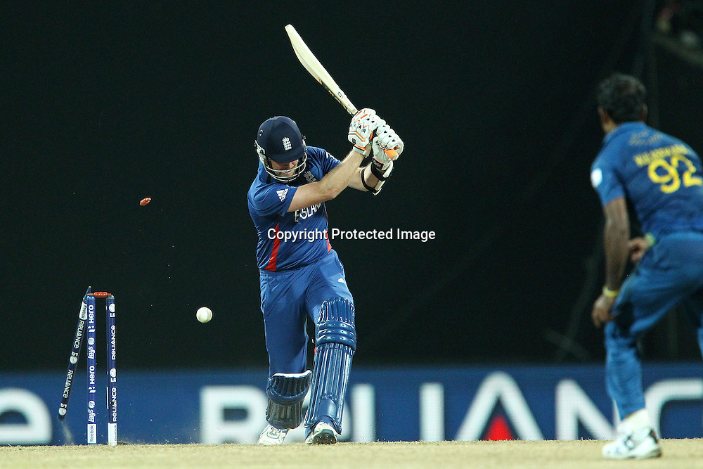 Graeme Swann of England  is bowled by Nuwan Kulasekara during the ICC World Twenty20 Super Eights match between England and Sri Lanka held at the  Pallekele Stadium in Kandy, Sri Lanka on the 1st October 2012<br /> <br /> Photo by Ron Gaunt/SPORTZPICS