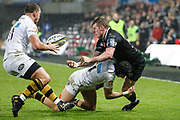 Dafydd Howells of the Ospreys offloads during the Anglo Welsh Cup match between Ospreys and Wasps at The Liberty Stadium, Swansea, Wales on 10 November 2017. Photo by Andrew Lewis.