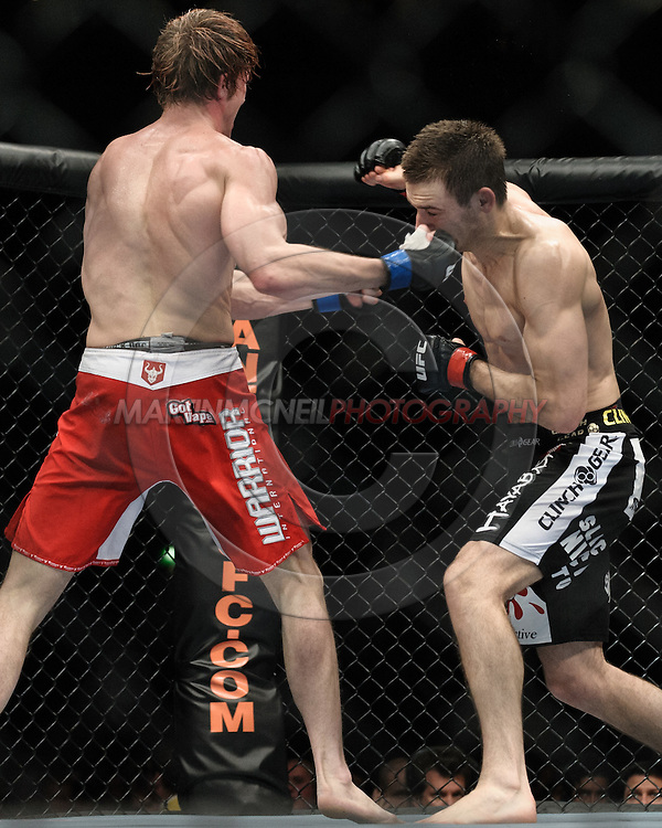 """MANCHESTER, ENGLAND, NOVEMBER 14, 2009: Matthew Riddle and Nick Osipczak during """"UFC 105: Couture vs. Vera"""" inside the MEN Arena in Manchester, United Kingdom."""