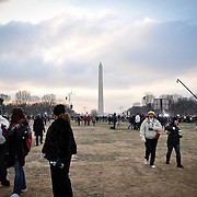 Thousands roamed the National Mall to soak up the atmosphere, pose for photos and stake out the spot they hope to secure during the inaugural ceremony.