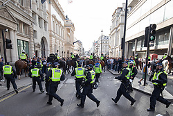 © Licensed to London News Pictures. 13/10/2018. London, UK. The Democratic Football Lads Alliance clash with a counter demonstration organised by Stand Up To Racism and Unite Against Fascism. The FLA were due to hold a silent march in Central London. Strict conditions have been imposed upon the march to prevent 'serious disorder' following previous demonstrations.  Photo credit : Tom Nicholson/LNP