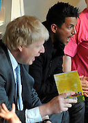 © Licensed to London News Pictures. 06/12/2011, London, UK. (L) BORIS JOHNSON and (R )PETER ANDRE launch  the Love Libraries scheme at Shepherds Bush Library, London, Today 6th December. Love Libraries is a new scheme to encourage Londoners to read and participate in activities at their local libraries. Photo credit : Stephen Simpson/LNP