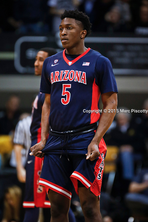 SHOT 2/26/15 9:09:42 PM - Arizona's Stanley Johnson #5 retakes the court after halftime during their regular season Pac-12 basketball game against Colorado at the Coors Events Center in Boulder, Co. Arizona won the game 82-54.<br /> (Photo by Marc Piscotty / &copy; 2015)