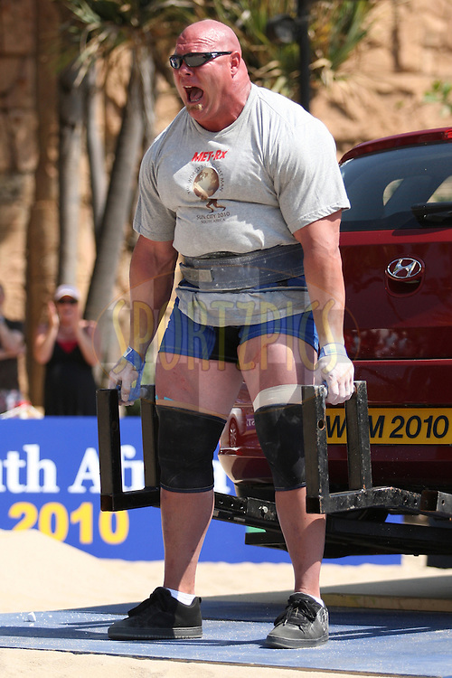 Nick Best (USA) feels the strain of the deadlift (for time) during one of the qualifying rounds of the World's Strongest Man competition held in Sun City, South Africa.