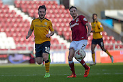 Northampton Town Midfielder Lawson D'ath gets a pass away under pressure from Newport County Midfielder Jake Gosling during the Sky Bet League 2 match between Northampton Town and Newport County at Sixfields Stadium, Northampton, England on 25 March 2016. Photo by Dennis Goodwin.