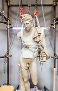 Rome, Vatican Museums, Massimo Bernacchi restoring  a Statue of Hermes, eorkshop in the Cortile Ottagono