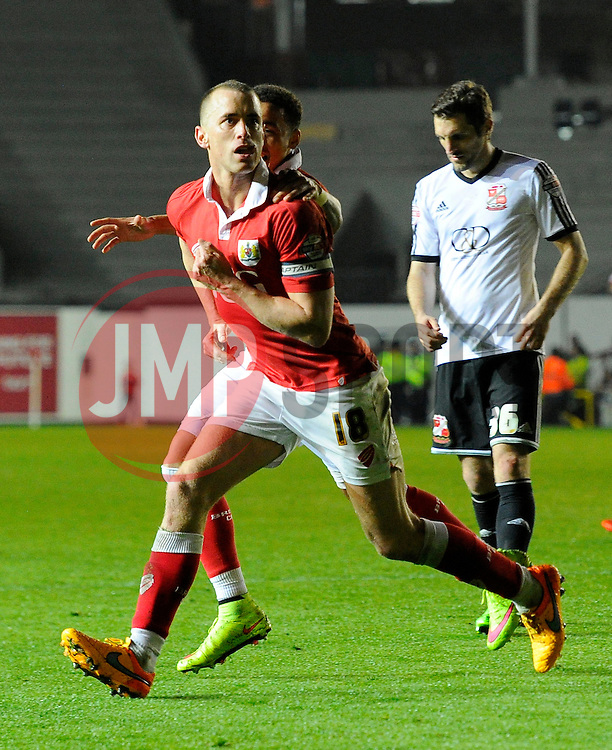 Bristol City's Aaron Wilbraham celebrates his goal with Bristol City's James Tavernier  - Photo mandatory by-line: Joe Meredith/JMP - Mobile: 07966 386802 - 07/04/2015 - SPORT - Football - Bristol - Ashton Gate - Bristol City v Swindon Town - Sky Bet League One
