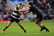 London - Saturday, December 5th 2009: Luke McAllister of New Zealand tackles Drew Mitchell of Barbarians  during the game at Twickenham, London. ..(Pic by Alex Broadway/Focus Images)