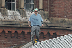 © Licensed to London News Pictures . 15/09/2015 . Manchester , UK . STUART HORNER on the roof at HMP Manchester (formerly Strangeways Prison ), this morning (15th September 2015) . Photo credit: Joel Goodman/LNP