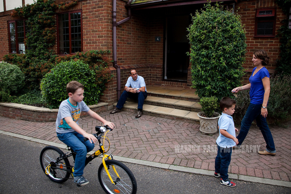 Julio and Eva Vildosola watch their sons play outside their new home, on September 1, 2012, in Buckden, England. The Spanish family immigrated to England due to the ongoing economic crisis that has impacted heavily on Spain. (Photo by Warrick Page)