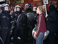 Riot police being confronted by a protestor on Mayday demonstration, London.