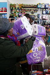 © Licensed to London News Pictures. 14/03/2020. London, UK. Shoppers panic-buying toilet rolls in Savers, north London. 798 cases have been tested positive and 11 patients have died from the virus in the UK. Photo credit: Dinendra Haria/LNP