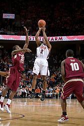 Virginia Cavaliers guard J.R. Reynolds (2) shoots over Florida State Seminoles guard Jason Rich (25).  The Virginia Cavaliers Men's Basketball Team defeated the Florida State Seminoles 73-70 at the John Paul Jones Arena in Charlottesville, VA on February 17, 2007.