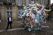 """Skulptur Projekte Muenster 4. .Curator Kasper Koenig next to """"Trickle Down. Public Space in the Era of its Privatization (Trickle Down. Der oeffentliche Raum im Zeitalter seiner Privatisierung)"""", 2007 by Andreas Siekman."""