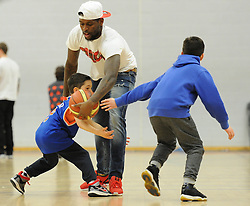 Jay Emmanuel-Thomas plays basketball with fans - Photo mandatory by-line: Dougie Allward/JMP - Mobile: 07966 386802 - 27/02/2015 - SPORT - basketball - Bristol - SGS Wise Campus - Bristol Flyers v Leeds Force - British Basketball League