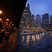Pedestrians walk under the Michigan Ave. bridge over a frozen Chicago River on Wednesday, Jan. 6, 2010.  (Brian Cassella/Chicago Tribune)