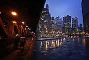 Pedestrians walk under the Michigan Ave. bridge over a frozen Chicago River on Wednesday, Jan. 6, 2010.  (Brian Cassella/Chicago Tribune)