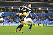 Brentford defender Maxime Colin watched by Birmingham City midfielder Jon Toral during the Sky Bet Championship match between Birmingham City and Brentford at St Andrews, Birmingham, England on 2 January 2016. Photo by Alan Franklin.