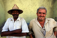 Two men outside the market in Cienfuegos, Cuba.