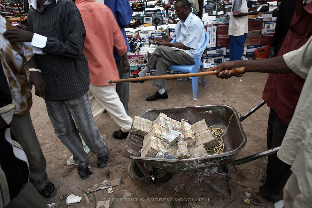 Somaliland Shillings are transported by wheel-barrow in Hargeisa, Somaliland, on Thursday, July 19, 2007. While the Somaliland Shilling has remained stable, at 6500 to the dollar, it is not a recognized currency and has no official exchange rate..