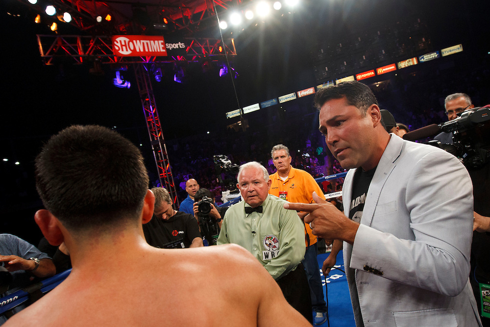 Oscar De La Hoya, promoter of the fight, talks to Leo Santa Cruz, as referee Lou Moret looks on, after Santa Cruz knocked out Victor Terrazas for the WBC Super Bantamweight Title Fight at the StubHub Center on Saturday, August 24, 2013 in Carson, California. Patrick T. Fallon/For The New York Times