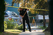 A police officer searches for evidence at the scene of a shooting on Hudson Avenue in Rochester, New York on Thursday, September 4, 2014. A Rochester Police Officer was shot and killed Wednesday night, Rochester's first officer killed in the line of duty since 1959. Officer Daryl Pierson, 32, was shot and killed. In May 2015, Thomas Johnson III was convicted of aggravated murder of a police officer.