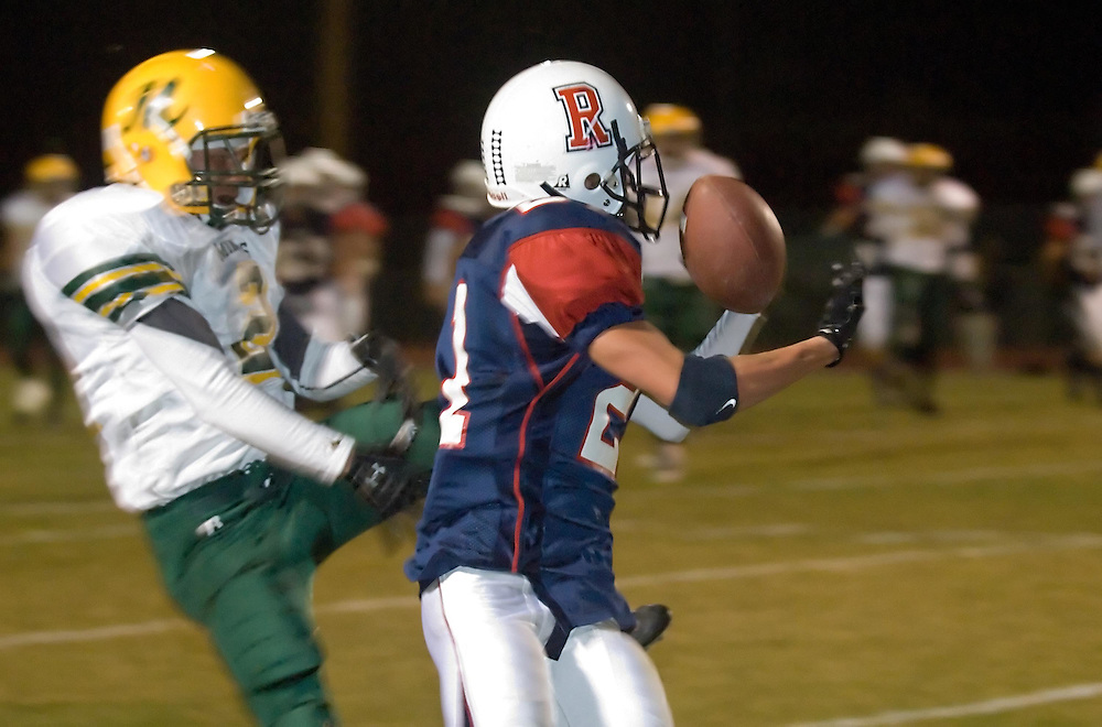 Reno High Schools Kyle Wirgler bobbles a pass near Bishop Manogue Catholic High School defender Vince Rossi, Friday, Nov. 2, 2007 at Foster Field in Reno during the first round of the Northern Nevada 4A playoffs...Photo by David Calvert/Reno Gazette-Journal