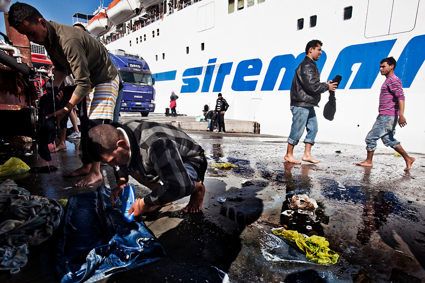 Daily life of would be immigrants on the Island of Lampedusa.More than 5000 would be immigrants are currently on the territory. The portual area of Lampedusa has become a second open air immigration centre where immigrants live in critical igienic and sanitary conditions.