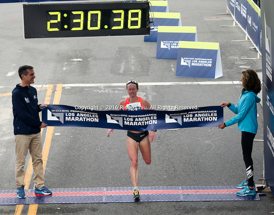 Nataliya Lehonkova of Ukraine, crosses the finish line to win the 31st Los Angeles Marathon in Los Angeles, Sunday, Feb. 14, 2016. The 26.2-mile marathon started at Dodger Stadium and finished at Santa Monica.  (Photo by Ringo Chiu/PHOTOFORMULA.com)<br /> <br /> Usage Notes: This content is intended for editorial use only. For other uses, additional clearances may be required.
