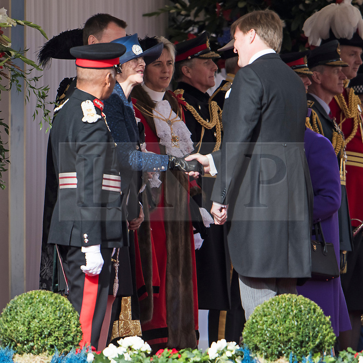 © Licensed to London News Pictures. 23/10/2018. London, UK. British Prime Minister Theresa May shakes the hand of King Willem-Alexander of the Netherlands, during a ceremony on Horse Guards Parade in London for the arrival of King Willem-Alexander and Queen Maxima of the Netherlands as part of a state visit to the UK. Photo credit: Ben Cawthra/LNP